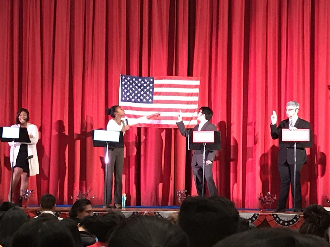 Students posing as Hillary Clinton, Donald Trump, Jill Stein, and Gary Johnson participate in the Mock Debate at Francis Lewis High School