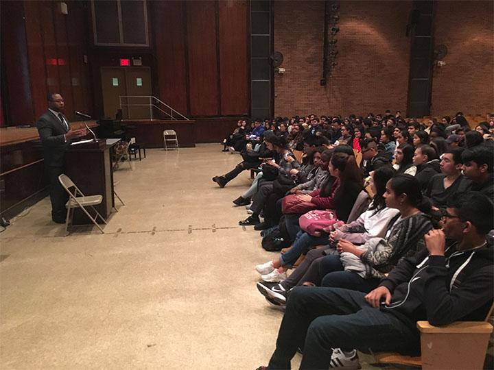 Innocence Project attorney Jarrett Adams speaks to students at Francis Lewis High School