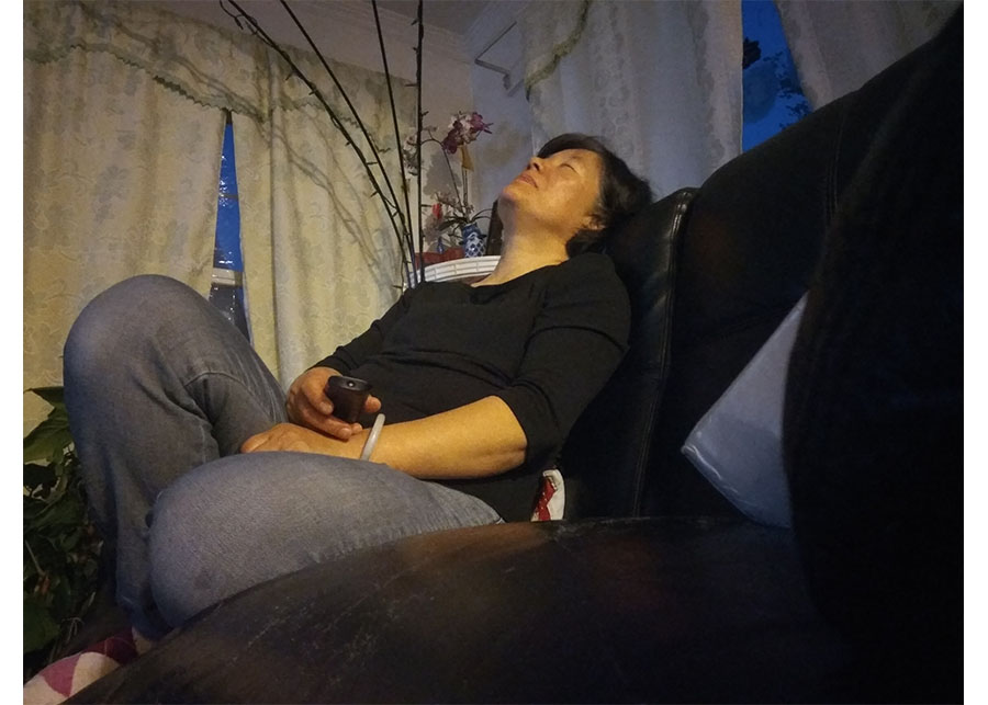 My mom who fell asleep after 5 min of watching TV. due to the tiredness from work.