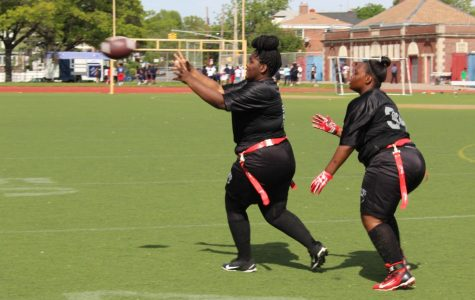 Paola Green and Christina Walker Robinson, both students at Francis Lewis High School, play in a flag football game