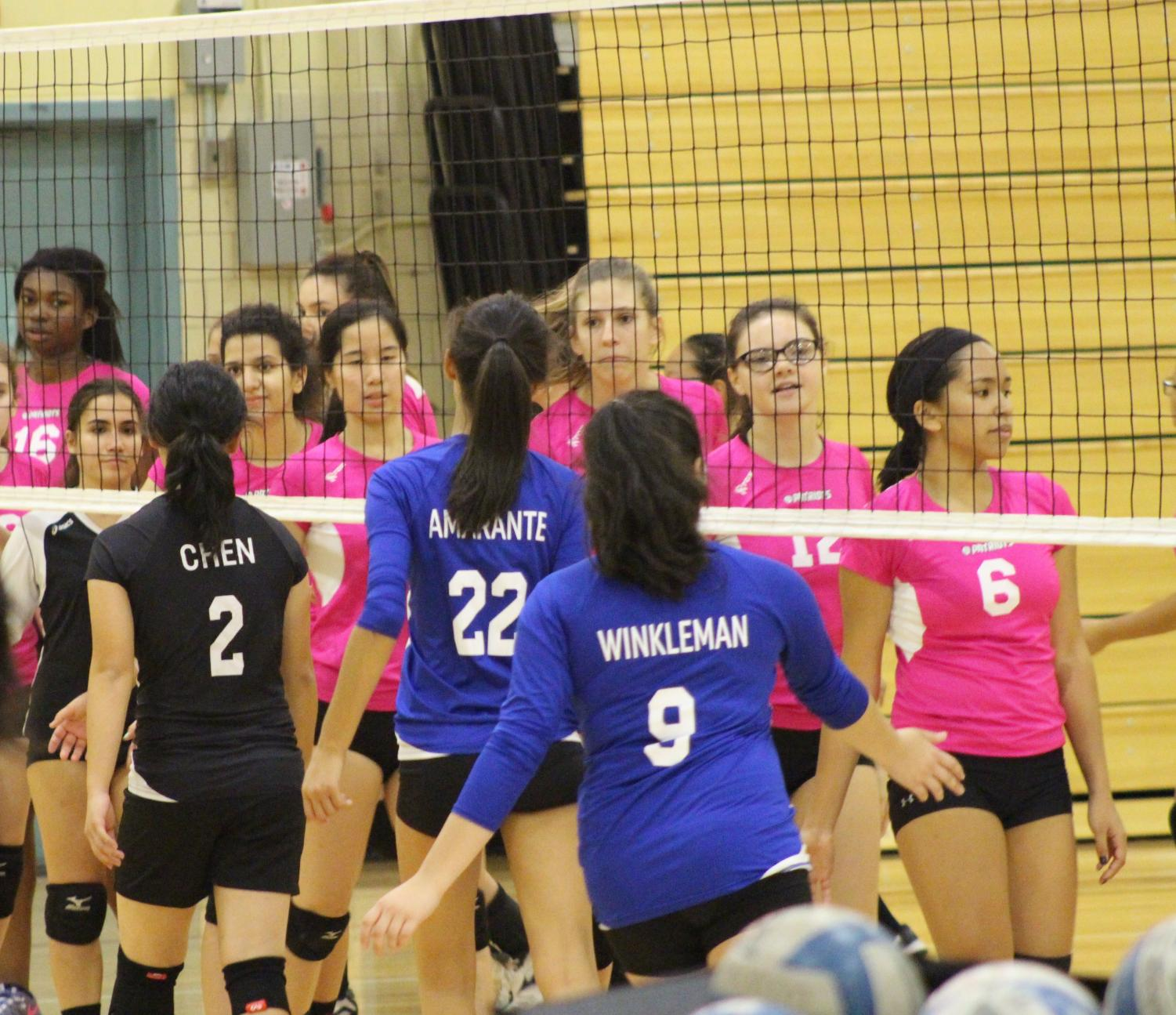 Francis Lewis shaking hands with the John Bowne Girls' Volleyball team after their 2-0 victory.