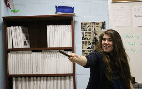 Harry Potter Club President Amber Lovett practices spells using a handmade wand.