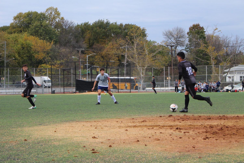 Daniel Jaramillo leads the team forward against Brooklyn Technical High School.