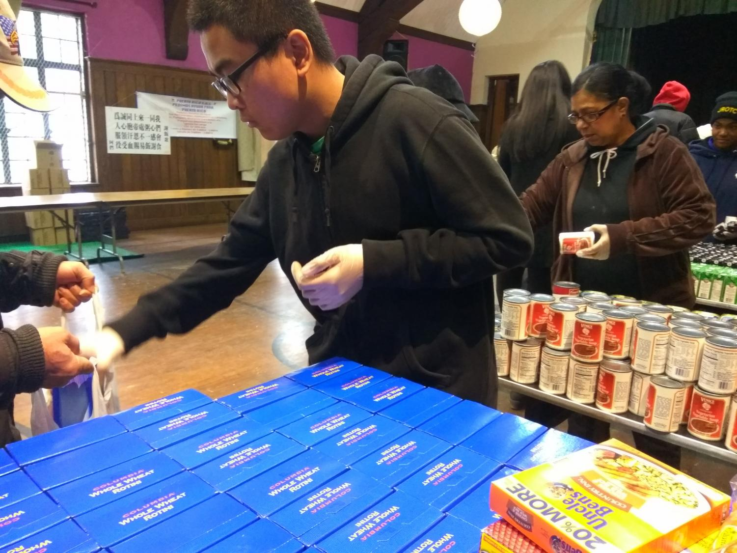 Volunteers distribute food donations at the St. George Church in Flushing.