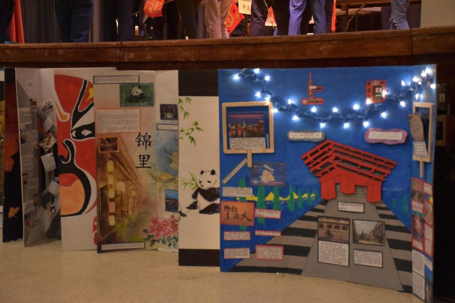 Chinese posters in the auditorium with information on cultural aspects such as the city of Shanghai.