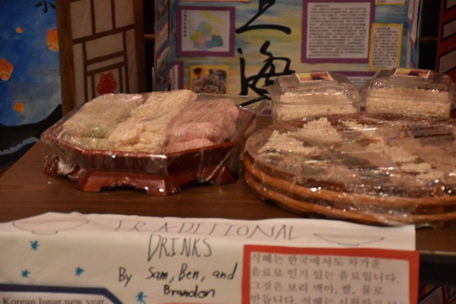 Korean snacks like ssal ro ppung are placed out for students to try eating.