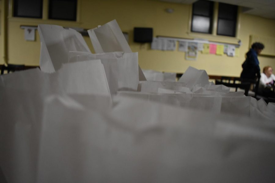 With Mother's Day just around the corner, high school volunteers lend a helping hand to the staff at Holy Trinity and Lutheran Church by putting together 100 paper bags filled with items to show mothers appreciation.