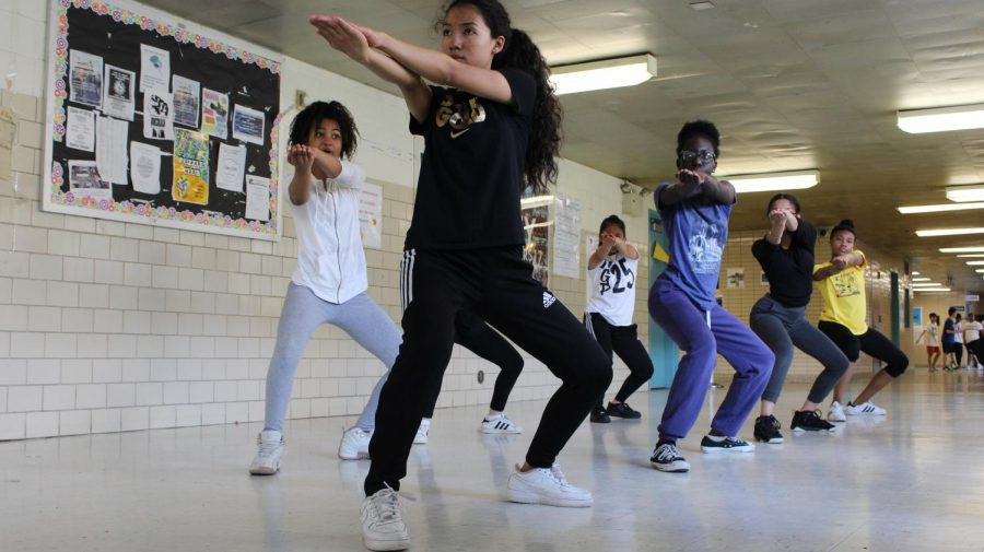 Members of the girls step team practice in the hallways of Francis Lewis High School