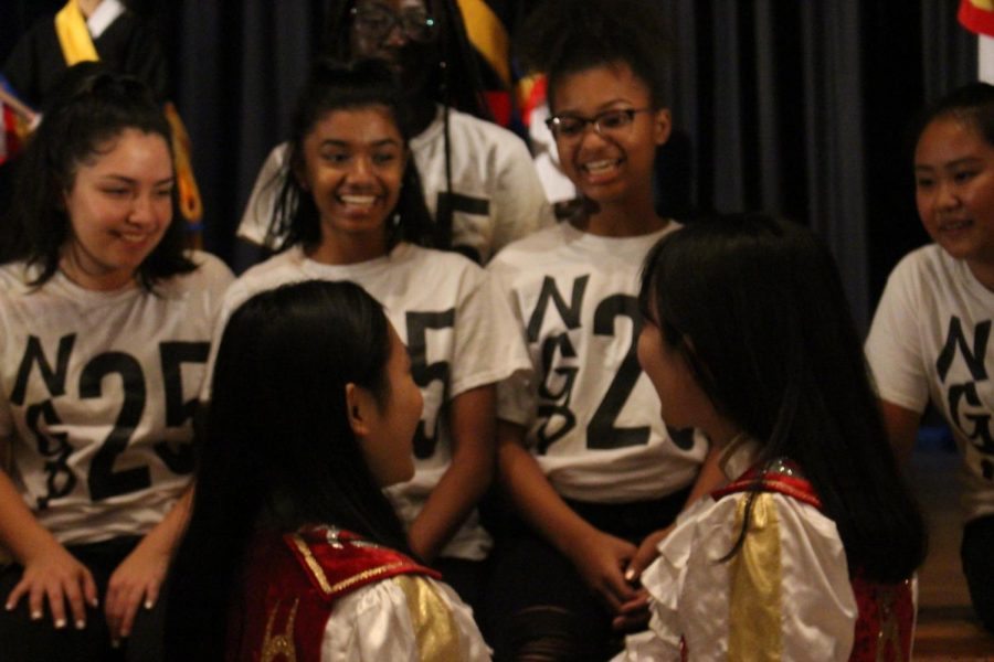 The girls Step Team taught Korean students to step simple routines onstage, and now get ready for a group picture. (top) Step team members and (bottom) Korean cheerleading squad interact with each other.