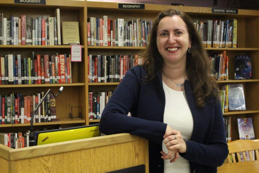 Assemblywoman Nily Rozic poses next to the podium in the library.
