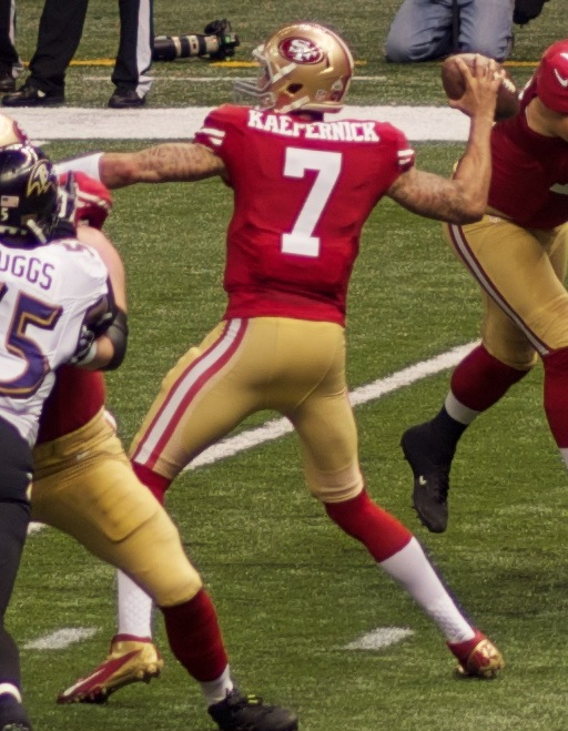 Colin Kaepernick, a former quarterback for the San Francisco 49ers, attempts a pass in Super Bowl XLVII