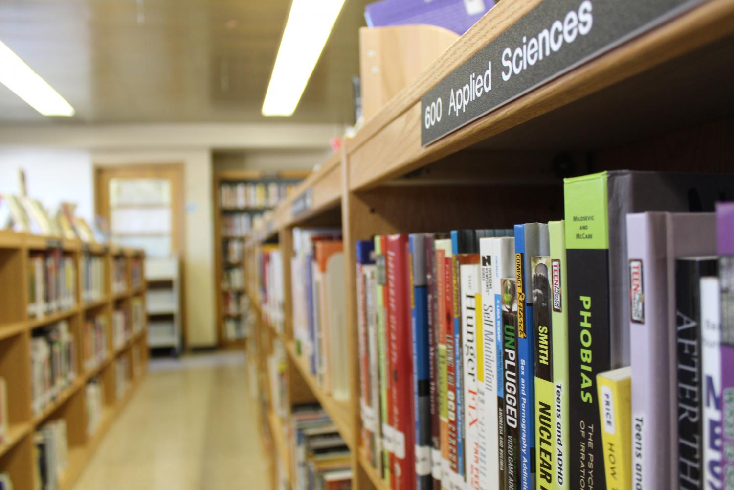 Books+of+various+genres+are+offered+to+students+to+borrow+and+learn+from.+The+wide+range+of+genres+range+from+Fiction+and+Romance+to+Applied+Sciences+and+American+History.