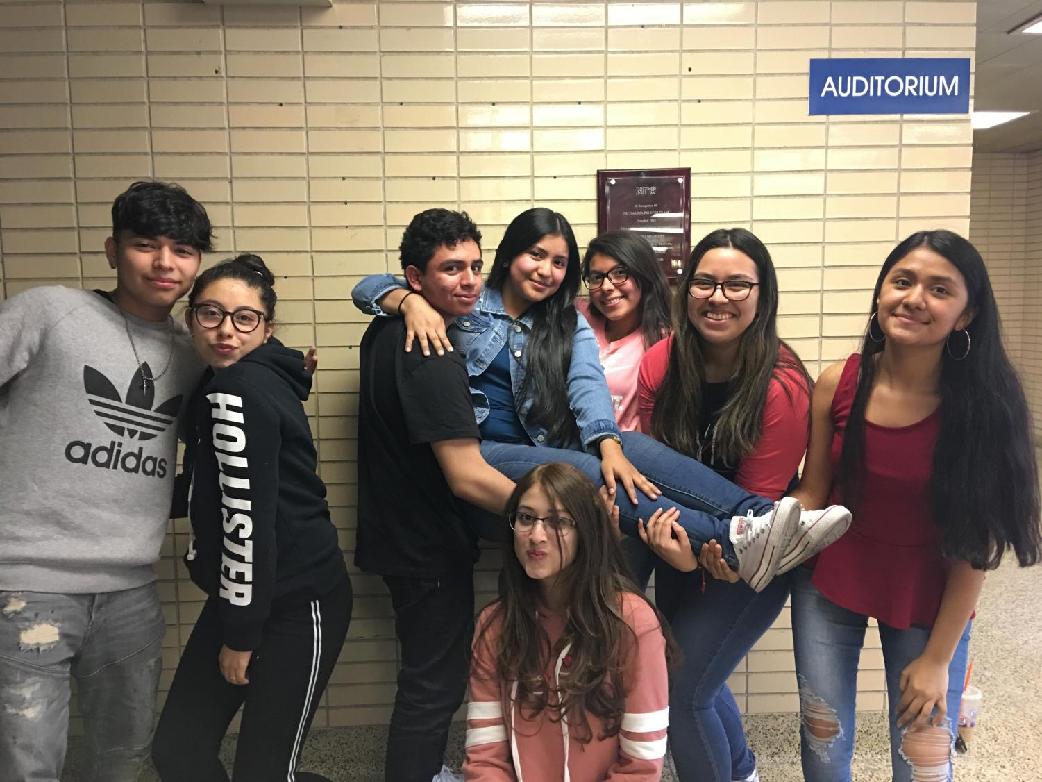 Johnna+is+also+part+of+the+Latinos+Unidos+Club.+Honoring+their+friend+Johnna%2C+her+friends+displayed+their+camaraderie+for+Johnna+and+her+enlistment+in+front+of+the+auditorium%2C+where+they+practiced+for+the+International+Festival.