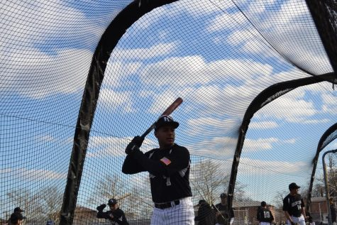 Peralta practices his swing in preparation for a scrimmage against Saint Francis Preparatory School.