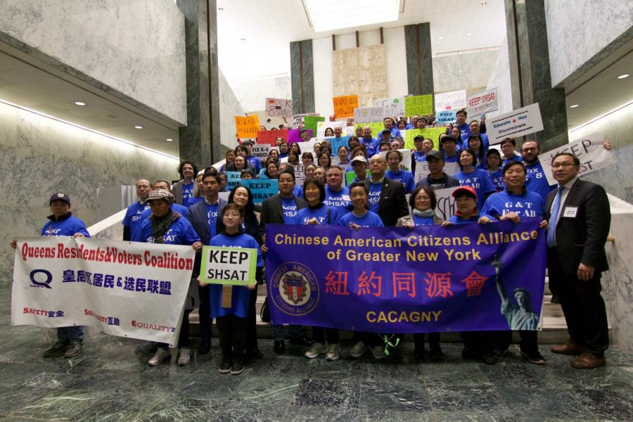Members of the Keep SHSAT chant in protest against Mayor Bill de Blasio's call to eliminate the SHSAT.