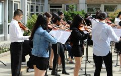 The Francis Lewis String Orchestra performs music for guests.