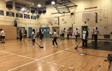 Students in Mr. Mckay's class play hockey after their exercises.