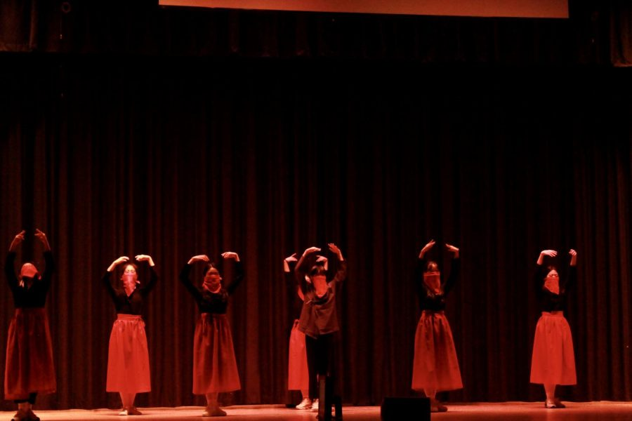 Dongtan's Kpop/Hip Hop dance team starts their dance with sheet like masks that represent elegance and grace.