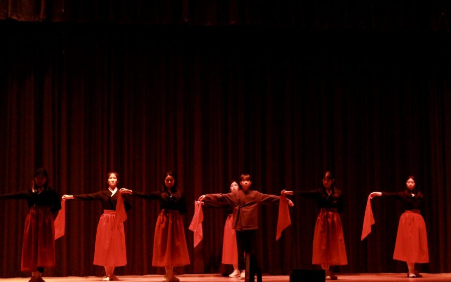 Dongtan's Kpop/Hip Hop dance team begins their dance with sheet like masks that represent elegance and grace.