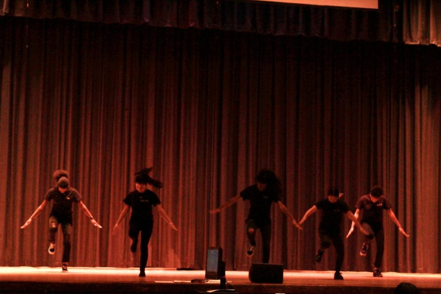 Francis Lewis's Step team wows the audience with their loud energy and teamwork.