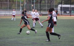 Cabral advances towards the goal, scoring her first goal of the playoff season.