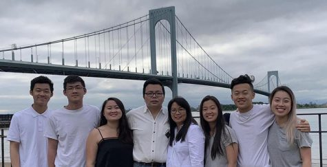 Brandon Yam (far left), his parents and 5 siblings.