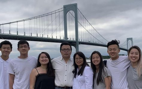 Brandon Yam (far left), his parents and 5 siblings.