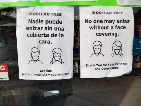 Signs in front of the Dollar Tree ask customers that they must wear a mask when inside the store. They will not be permitted entry without a mask.
