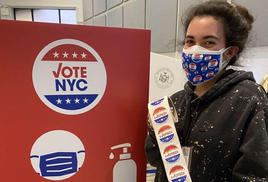 Abby Katzap, a senior at Francis Lewis, volunteered as a poll worker where she handed out ballots and directed voters after checking them in. She was only able to hand out one sticker before she had to attend to her main responsibilities.